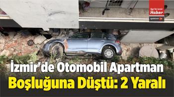 İzmir'de Otomobil Apartman Boşluğuna Düştü: 2 Yaralı