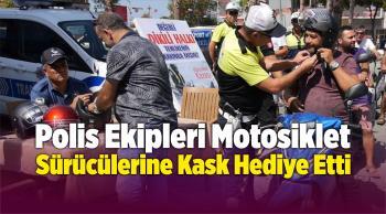 Polis Ekipleri Motosiklet Sürücülerine Kask Hediye Etti