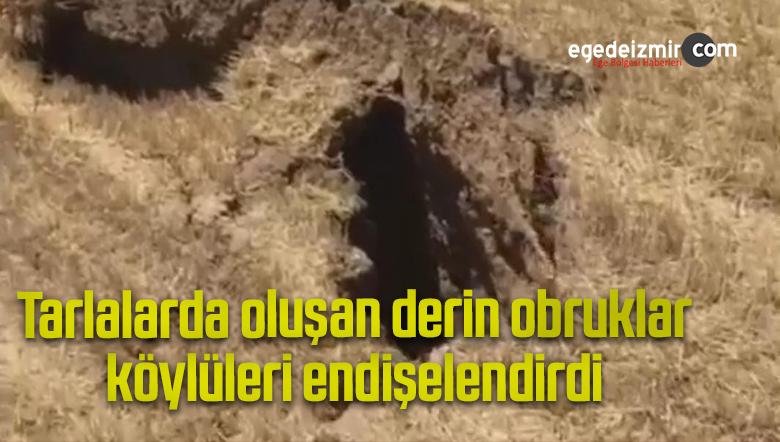 Tarlalarda oluşan derin obruklar köylüleri endişelendirdi