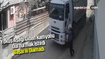 Yokuş aşağı giden kamyonu durdurmak istedi, başarılı olamadı