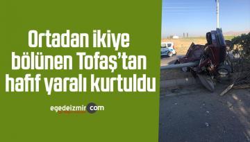 Ortadan ikiye bölünen Tofaş'tan hafif yaralı kurtuldu