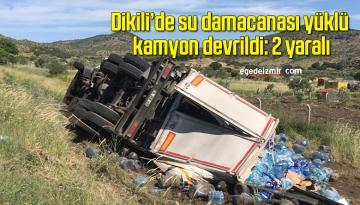 Dikili'de su damacanası yüklü kamyon devrildi: 2 yaralı