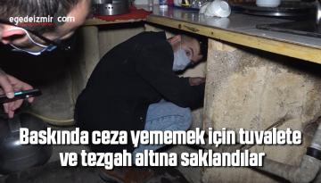 Baskında ceza yememek için tuvalete ve tezgah altına saklandılar