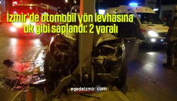 İzmir'de otomobil yön levhasına ok gibi saplandı: 2 yaralı