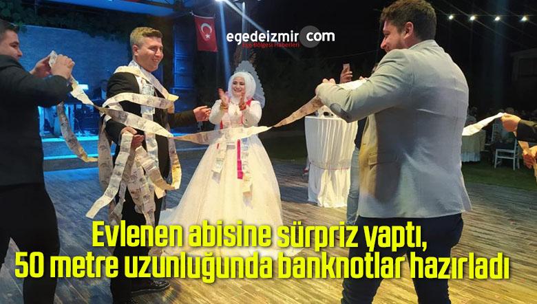 Evlenen abisine sürpriz yaptı, 50 metre uzunluğunda banknotlar hazırladı